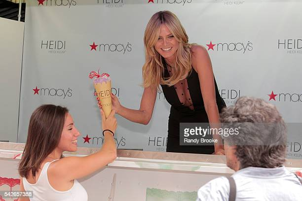 Heidi Klum poses outside Macy's in her ice cream truck while handing out ice cream during the Heidi Klum Hosts Lingerie Party at Macy's Herald Square...