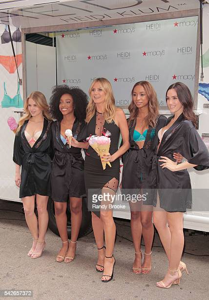 Heidi Klum poses outside Macy's with models wearing some of her collection during the Heidi Klum Hosts Lingerie Party at Macy's Herald Square on June...