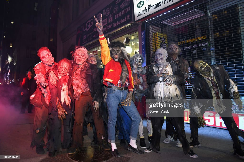 Heidi Klum (C) poses with her zombies as she enters Heidi Klum's 18th Annual Halloween Party presented by Party City and SVEDKA Vodka at Magic Hour Rooftop Bar & Lounge at Moxy Times Square on October 31, 2017 in New York City.