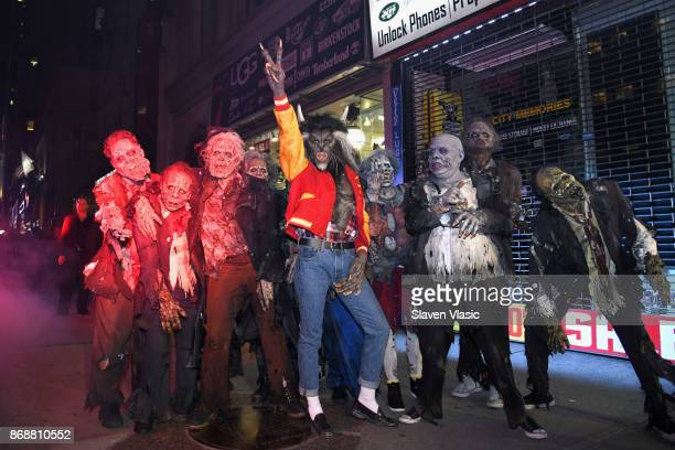 Heidi Klum poses with her zombies as she enters Heidi Klum's 18th Annual Halloween Party presented by Party City and SVEDKA Vodka at Magic Hour...