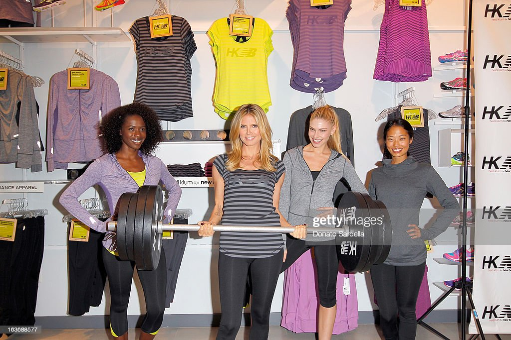 Heidi Klum (2nd L) poses with (L-R) models Porsche Thomas, Sarah Otey and Jennifer An at the launch of her new Heidi Klum for New Balance Collection at Lady Foot Locker on March 14, 2013 in Culver City, California.