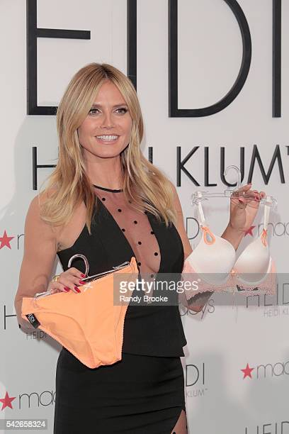 Heidi Klum poses with some of her lingerie on Macy's 6th floor during the Heidi Klum Hosts Lingerie Party at Macy's Herald Square on June 23 2016 in...
