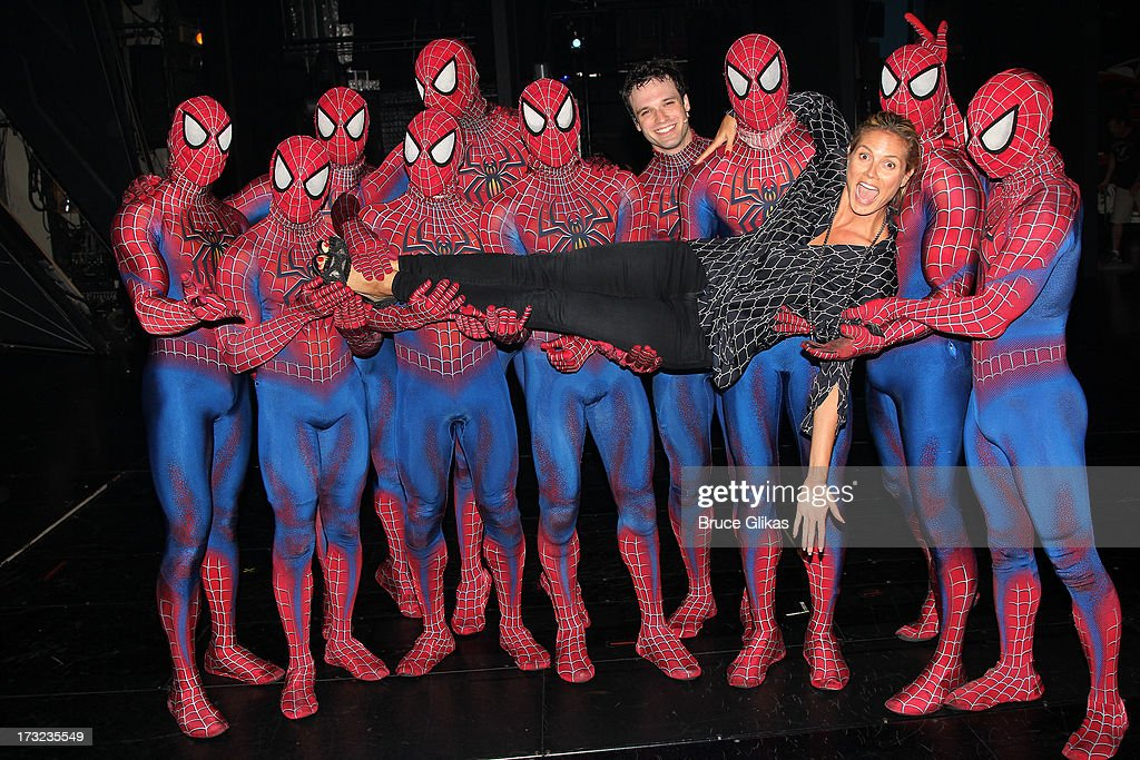 Heidi Klum poses with the cast backstage at the hit musical 'Spider-Man: Turn Off The Dark' at The Foxwoods Theater on July 10, 2013 in New York City.