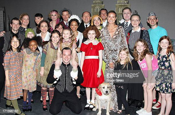 Heidi Klum poses with the cast backstage at the musical 'Annie' on Broadway at The Palace Theater on June 23 2013 in New York City