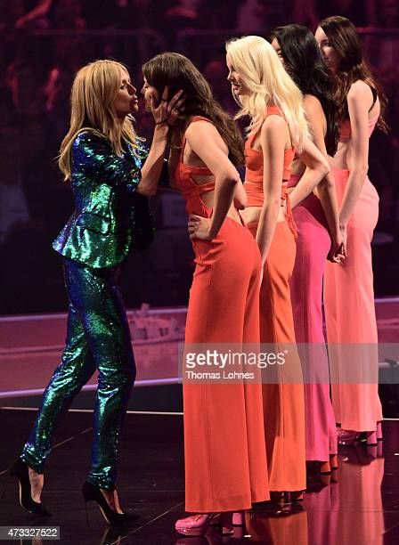 Heidi Klum reacts with the models Vanessa, Katharina, Anuthida and Ajsa during the final of the tv show 'Germany's Next Topmodel' at SAP Arena on May...