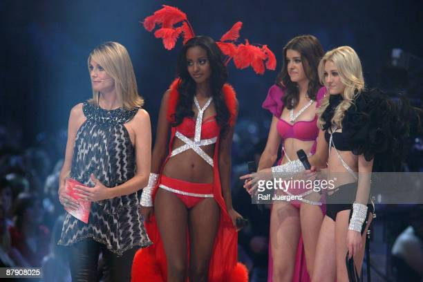Heidi Klum Sara Nuru Marie Nasemann and Mandy Bork are shown onstage during the PRO7 TV show 'Germany's Next Topmodel Final' at the Lanxess Arena on...