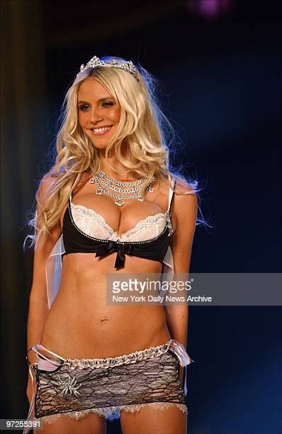 Heidi Klum shows off some lacy undergarments as she walks the runway during the Victoria's Secret Fashion Show at the Lexington Avenue armory