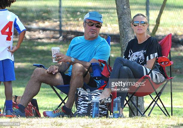 Heidi Klum sits on the sideline with Flavio Briatore as she watches her children Leni Johan and Lou play soccer in Brentwood on September 08 2013 in...