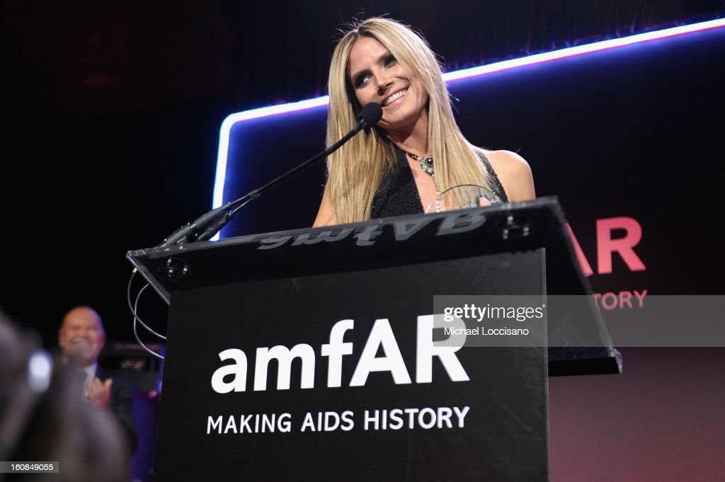 Heidi Klum speaks onstage at the amfAR New York Gala to kick off Fall 2013 Fashion Week at Cipriani Wall Street on February 6, 2013 in New York City.