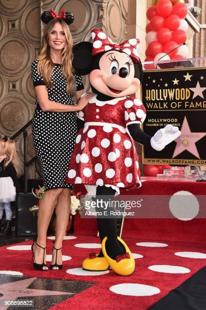 Heidi Klum stands with Minnie Mouse during a star ceremony in celebration of the 90th anniversary Disney's Minnie Mouse at the Hollywood Walk of Fame...