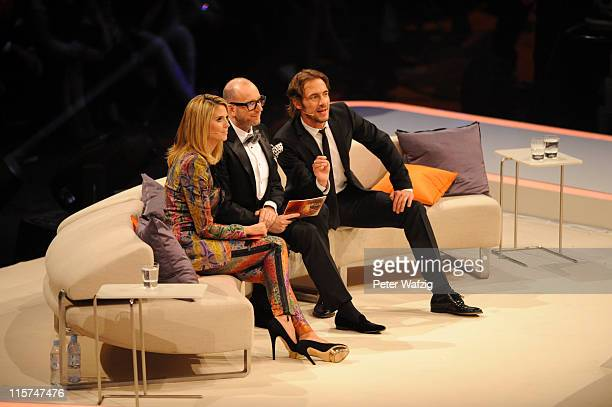 Heidi Klum Thomas Rath and Thomas Hayo look at the finalists during the finalists show of 'Germany's Next Topmodel' at the LanxessArena on June 09...