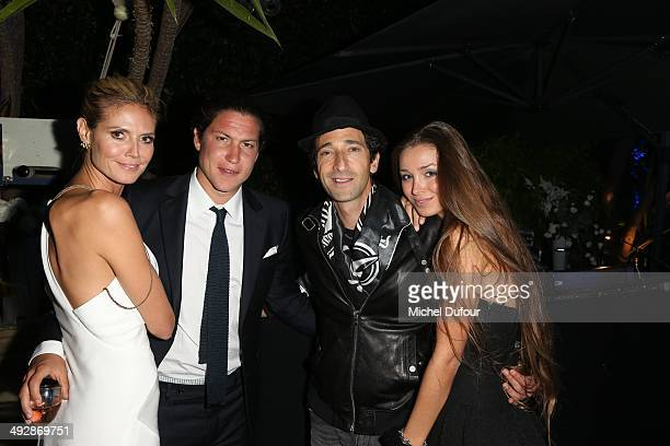 Heidi Klum Vito Schnabel Adrien Brody and Lara Leito attend the Puerto Azul Experience Inside Party at the 67th Annual Cannes Film Festival on May 21...