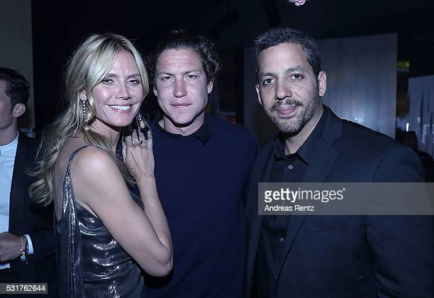 Heidi Klum Vito Schnabel and David Blaine attend The Harmonist Cocktail Party during The 69th Annual Cannes Film Festival at Plage du Grand Hyatt on...