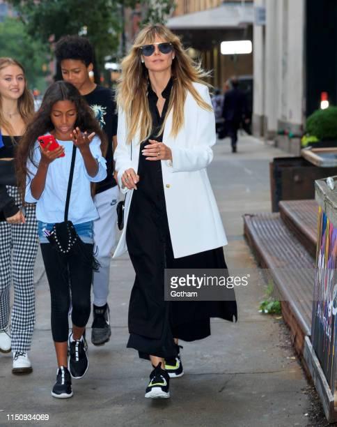 Heidi Klum walks to dinner with her kids on June 19 2019 in New York City