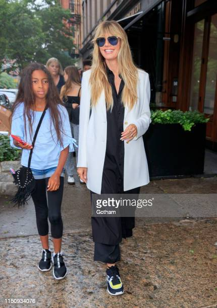 Heidi Klum walks to dinner with her kids on June 19, 2019 in New York City.