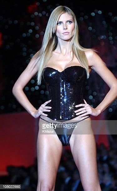 Heidi Klum wearing black sequined corset and black Victoria Secret second skin satin string bikini