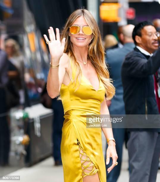 Heidi Klum wears a gold dress at GMA on July 6 2017 in New York City