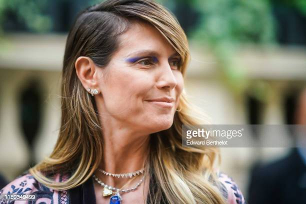 Heidi Klum wears necklaces an embroidered floral print palepink jacket outside AMFAR dinner during Paris Fashion Week Haute Couture Fall/Winter...