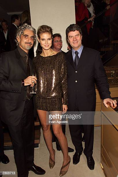 Heidi Klum with husband Rick Pepino and the Louis Vuitton Exec at the grand opening of the Louis Vuitton Fifth Avenue Store in New York City Photo...