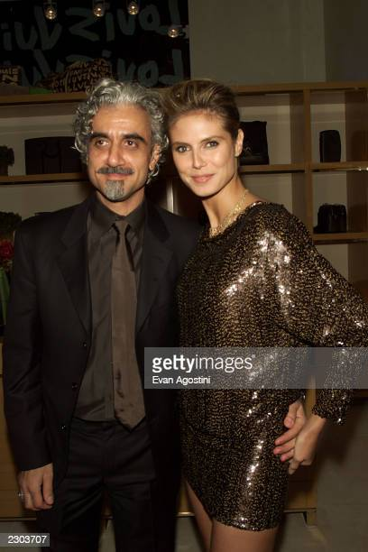 Heidi Klum with husband Rick Pepino at the grand opening of the Louis Vuitton Fifth Avenue Store in New York City Photo Evan Agostini/Getty Images
