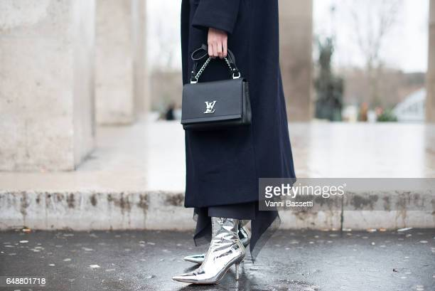 Heidi Lee poses with a Louis Vuitton bag after the Valentin Yudashkin show at the Palais de Tokyo during Paris Fashion Week Womenswear FW 17/18 on...