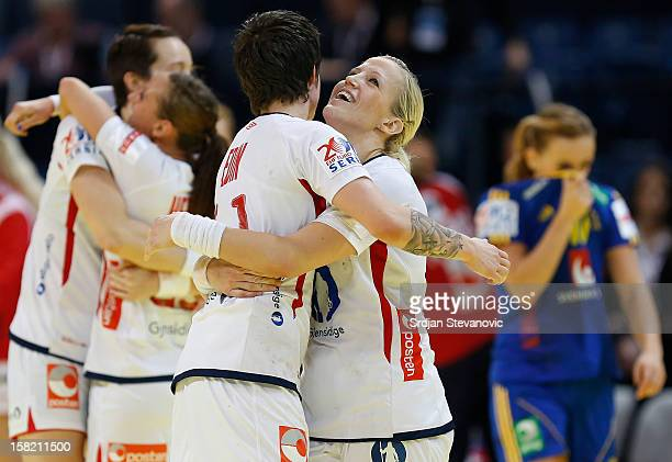 Heidi Loke and Anja Edin of Norway celebrate victory over Sweden after the Women's European Handball Championship 2012 Group I main round match...