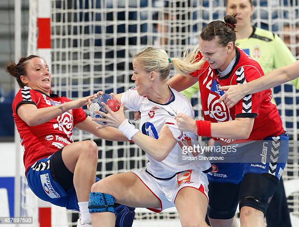 Heidi Loke of Norway is challenged by Katarina Krpez and Dragana Cvijic of Serbia during the 2013 World Women's Handball Championship 2013 match...