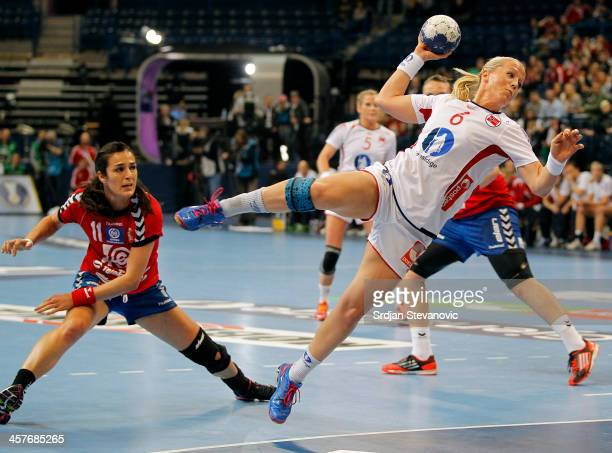 Heidi Loke of Norway scores a goal past Sanja Damnjanovic of Serbia during the 2013 World Women's Handball Championship 2013 match between Serbia and...
