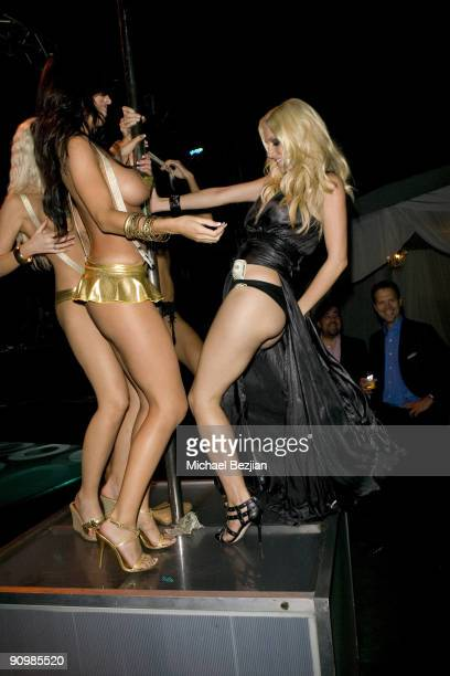 BEVERLY HILLS CA SEPTEMBER 18 Heidi Montag and playmates dance on a strip pole at the Stander Launch Party at The Playboy Mansion on September 18...