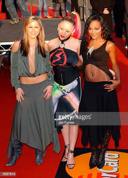 Heidi Mutya and Keisha members of the pop group Sugababes arrive for the Brit Awards 2003 at Earls Court London on February 20 2003 The group won the...