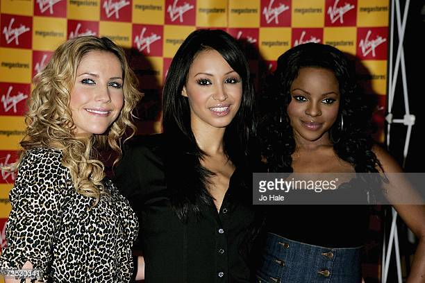 Heidi Range Amelie Berrabah and Keisha Buchanan of the Sugababes pose at the Virgin Megastore on Oxford Street for the launch of their new album...