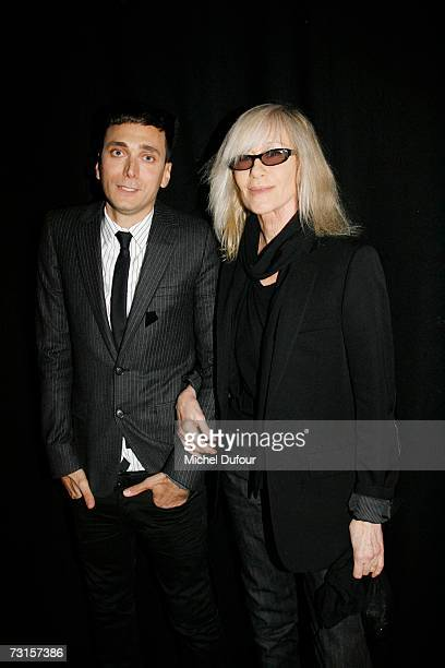 Heidi Slimane with Betty Catroux attends the Dior Men Fashion Show Autumn Winter 07 08 on January 30 2007 in Paris France