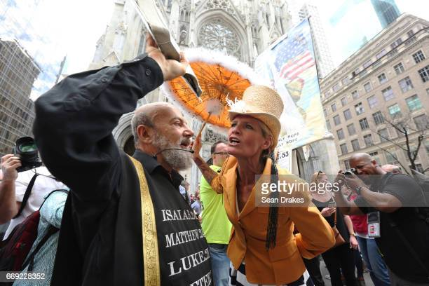 Heidi Staun of Copenhagen Denmark confronts demonstrators opposed to Easter celebrations on Fifth Avenue at St Patrick's Cathedral on April 16 2017...