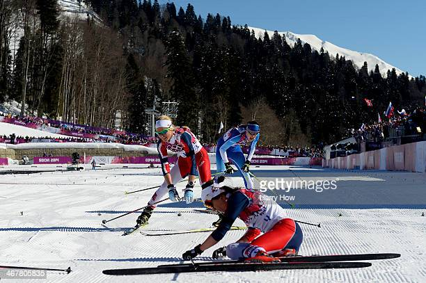 Heidi Weng and Therese Johaug of Norway collapse in the snow after competing in the Ladies' Skiathlon 75 km Classic 75 km Free during day one of the...