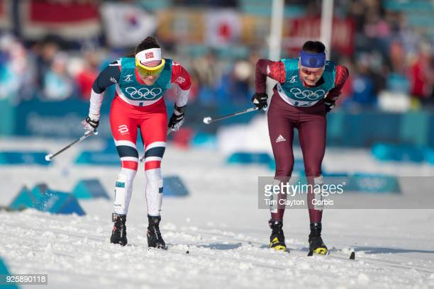 Heidi Weng of Norway and Anastasia Sedova an Olympic Athlete of Russia in action during the CrossCountry Skiing Ladies' 30km Mass Start Classic at...