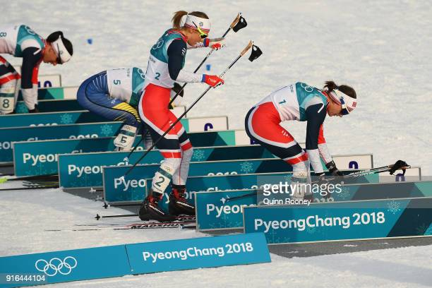 Heidi Weng of Norway and Ingvild Flugstad Oestberg of Norway compete during the Ladies Cross Country Skiing 75km 75km Skiathlon on day one of the...