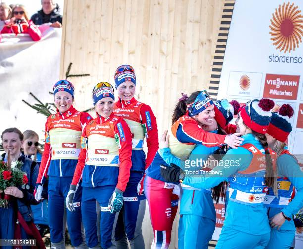 Heidi Weng of Norway congratulations Russian team Yulia Belorukova of Russia Anastasia Sedova of Russia Anna Nechaevskaya of Russia Natalia Nepryaeva...
