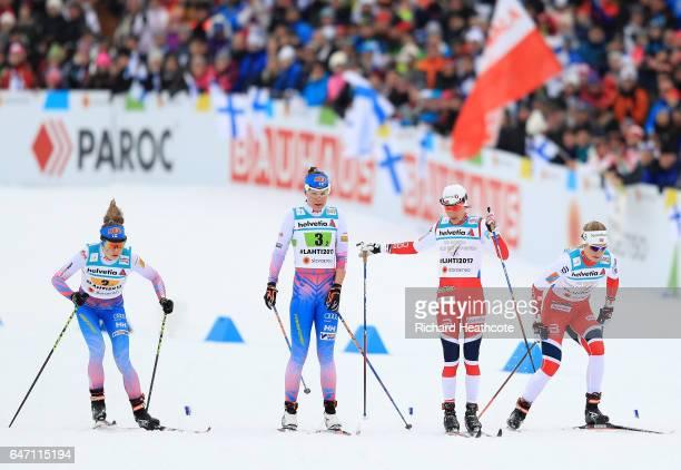 Heidi Weng of Norway hands over to Astrid Uhrenholdt Jacobsen of Norway alongside Kerttu Niskanen of Finland and Laura Mononen of Finland during the...