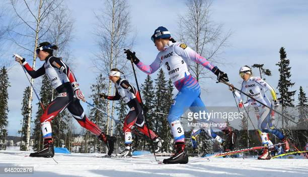 Heidi Weng of Norway Krista Parmakoski of Finland and Stina Nilsson of Sweden compete in the Women's Cross Country Skiathlon during the FIS Nordic...