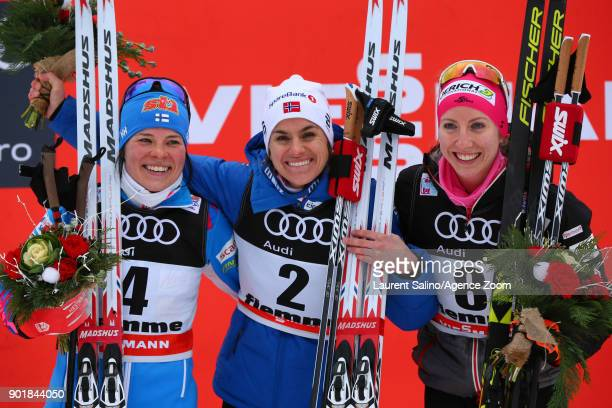 Heidi Weng of Norway takes 1st place Krista Parmakoski of Finland takes 2nd place Teresa Stadlober of Austria takes 3rd place during the FIS Nordic...