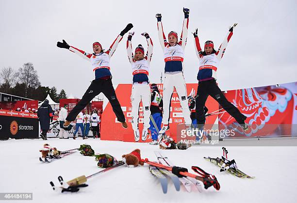 Heidi Weng, Therese Johaug, Astrid Uhrenholdt Jacobsen and Marit Bjoergen of Norway celebrate winning the gold medal in the Women's 4 x 5km...