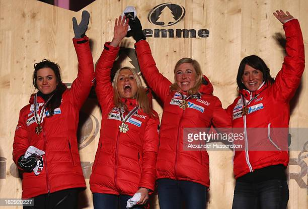 Heidi Weng Therese Johaug Kristin Steira and Marit Bjoergen of Norway celebrate victory with their Gold medals during the Medal Ceremony for the...