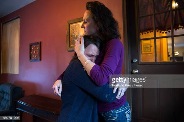 HeidiSue Stuart comforts her only surviving child Meghan Stuart Corey Coburn her son and Meghan's brother overdosed on fentanyl in November 2015...