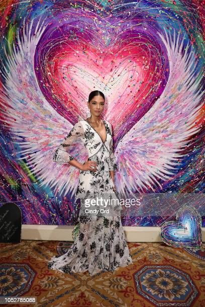 Heidy De La Rosa poses in front of the Angel Ball Wall by Fer Da Silva presented by ALECIAcom at the 2018 Angel Ball hosted by Gabrielle's Angel...