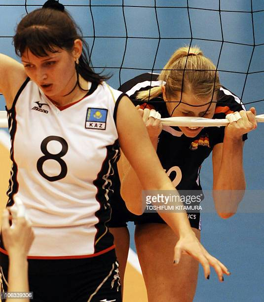 Heike Beier of Germany reacts to her missed spike beside Kazakhstan's Korinna Ishimtseva during their pool C match of the FIVB 2010 Women's...