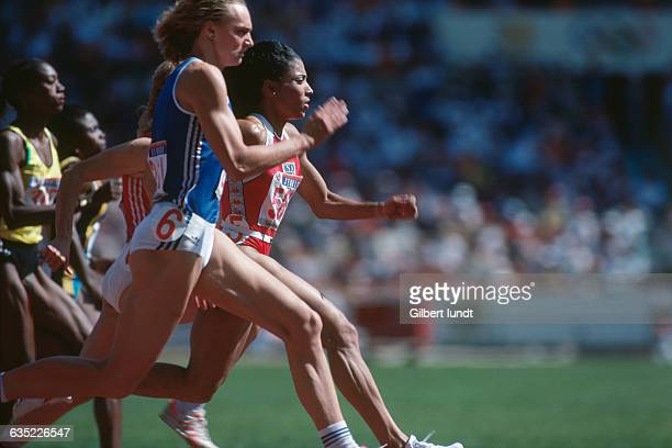 Heike Drechsler and Florence Griffith Joyner neckandneck during the semi finals of the Women's 100 meter sprint at the 1988 Olympic Games