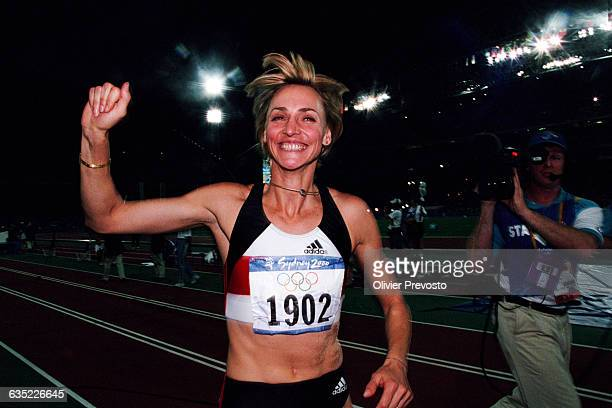 Heike Drechsler of Germany celebrates her gold medal win in the women's long jump final with a jump of 699 meters at the 2000 Olympics