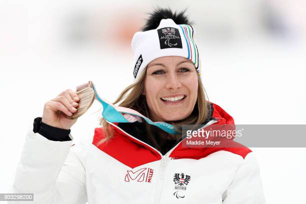 Heike Eder of Austria celebrates with her bronze medal after the Women's Sitting Slalom at Jeongseon Alpine Centre on Day 9 of the PyeongChang 2018...