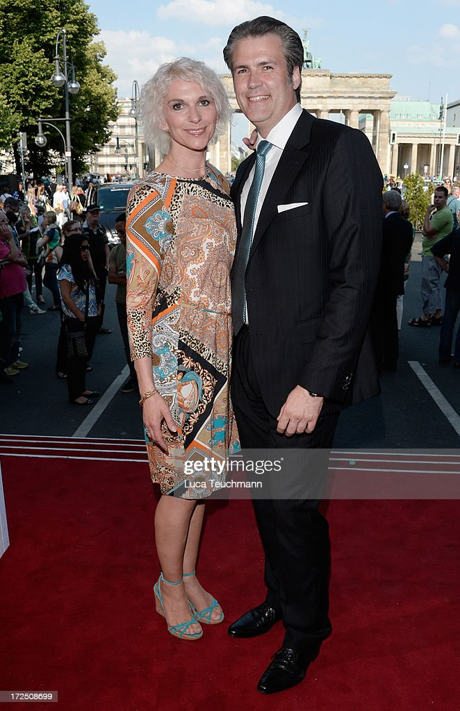 Heike Kloss and Harald Braun attend the Riani Show during Mercedes-Benz Fashion Week Spring/Summer 2014 at Brandenburg Gate on July 2, 2013 in Berlin, Germany.