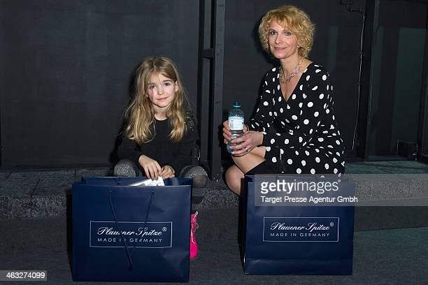 Heike Kloss and her daughter Olivia arrive to the Irene Luft show during MercedesBenz Fashion Week Autumn/Winter 2014/15 at Brandenburg Gate on...